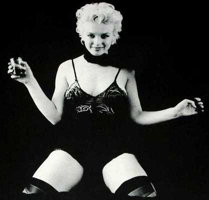 Marilyn Monroe in Black Setting Gelatin silver print 41 x 30 1/2 in. Hand-signed and numbered