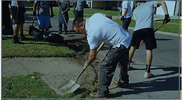 Neighbors assisting in annual neighborhood beautification event.
