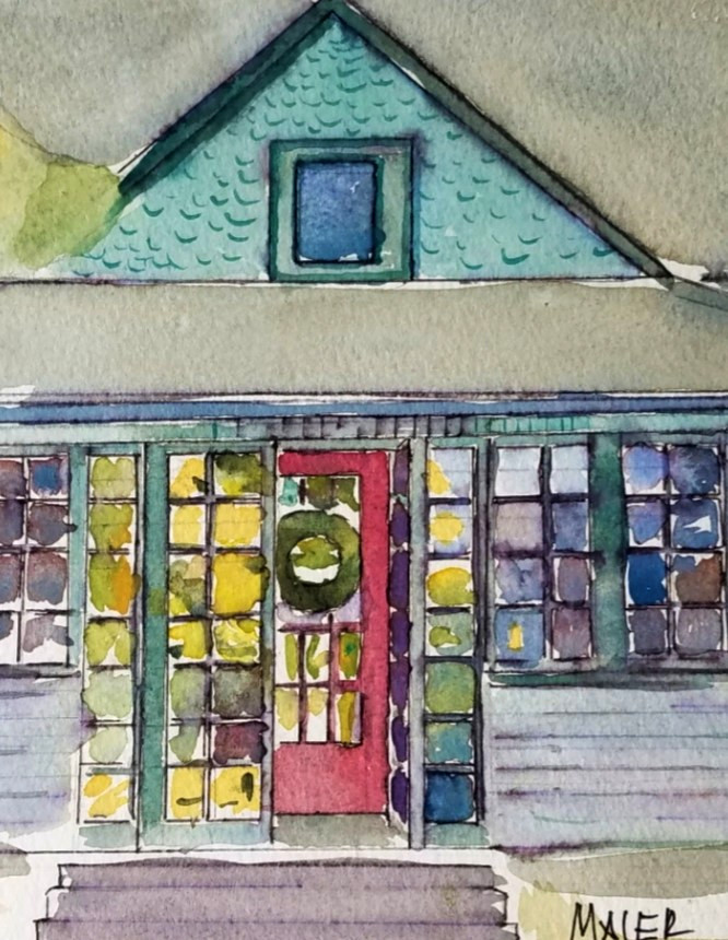 Watercolor painting of small house with a red door and a wreath hanging on the door