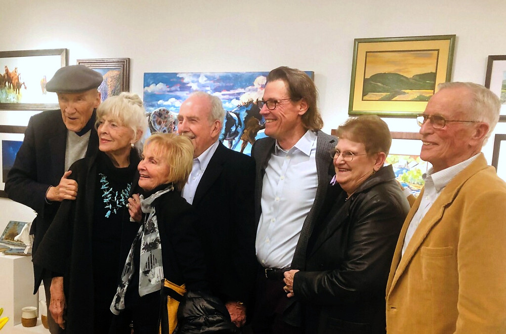 Group smiling at fine arts reception