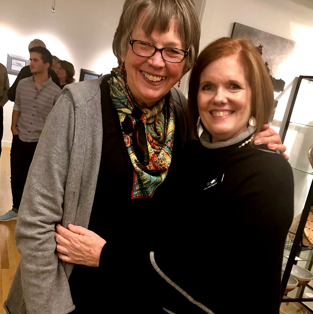Smiling women at the T. Allen Lawson Fine Arts Reception