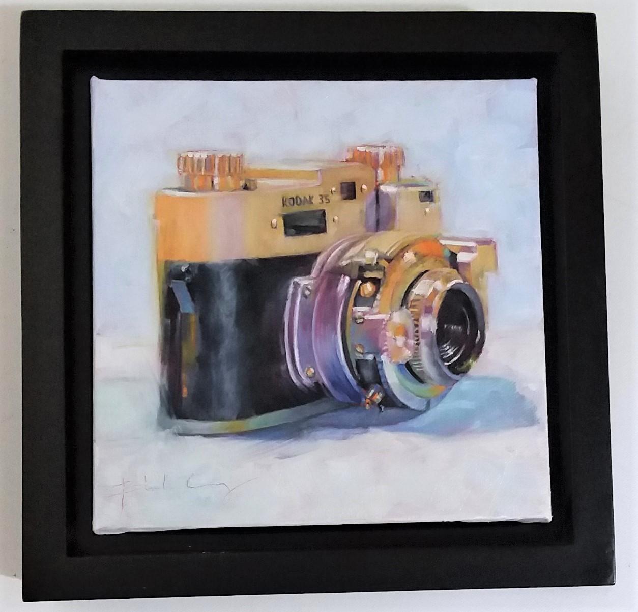 A framed oil painting of a Kodak camera