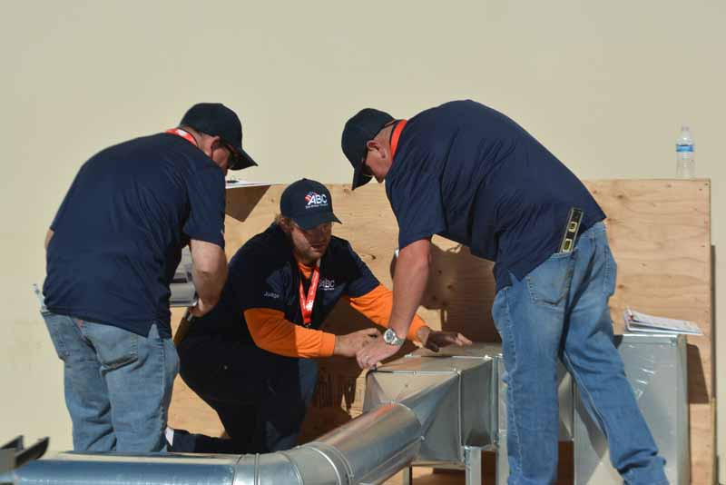 Judges review the winning sheet metal entry in the 2017 San Diego Craft Championships