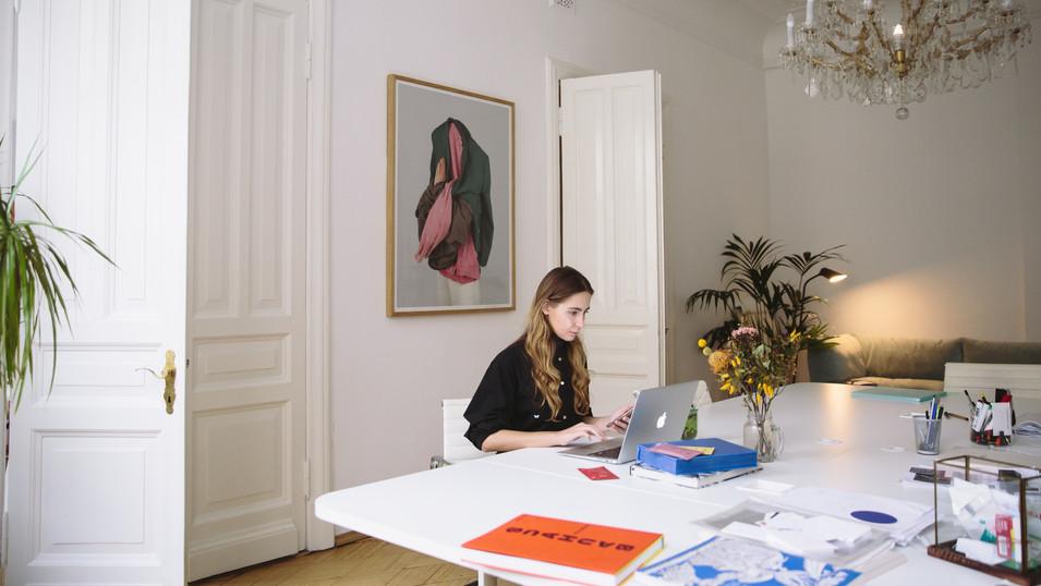 woman dinig room table laptop.jpg