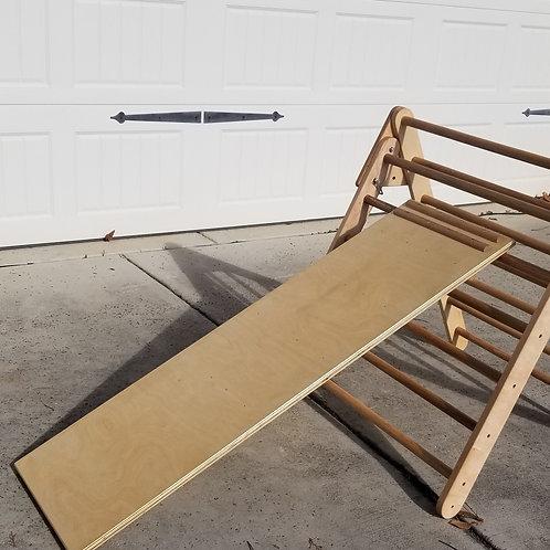 Handcrafted hardwood plywood slide. Educational equipment and furniture for fine motor development. Montessori styl