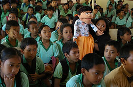 Using the puppets from the film characte