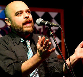 Alex Charalambides MassLEAP Managing Director Teaching Artist performing poetry