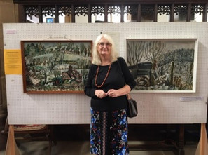 Avril Biggins with her paintings