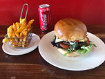 Burger, hot chips and a can of Coca Cola