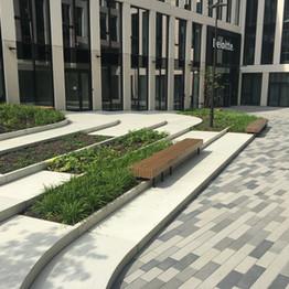 Manual sidewalks + wooden ledge  