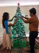 K Babumon & his wife Beena Babu decorating a Christmas Tree