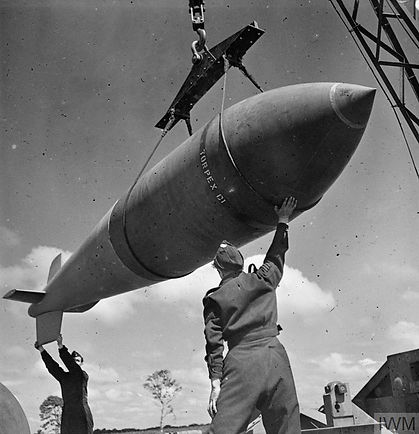 A Tallboy 12,000lb Bomb being taken from the bomb store