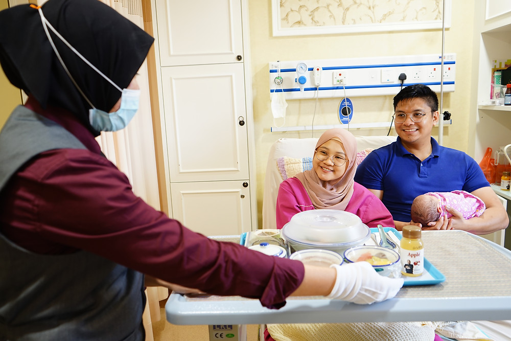 Lady Butler Serving In-Patient Meals (ANDORRA By Chef Zubir) to a Mother with her husband and baby by their side.
