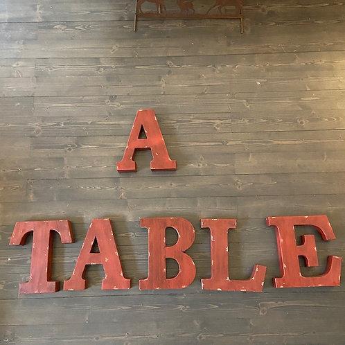 Scritta 'A TABLE'