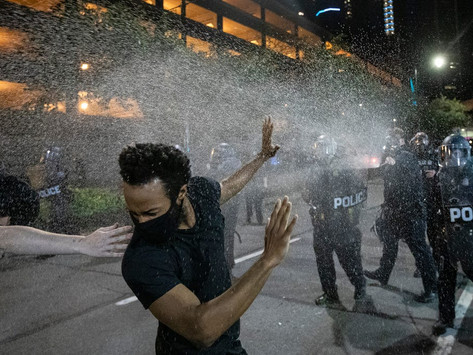 Man in a van shoots into a crowd of protesters in Detroit, killing a 19-year-old