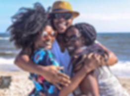 two-women-with-man-hugging-by-the-sea-93