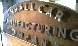 Thrall Car sign