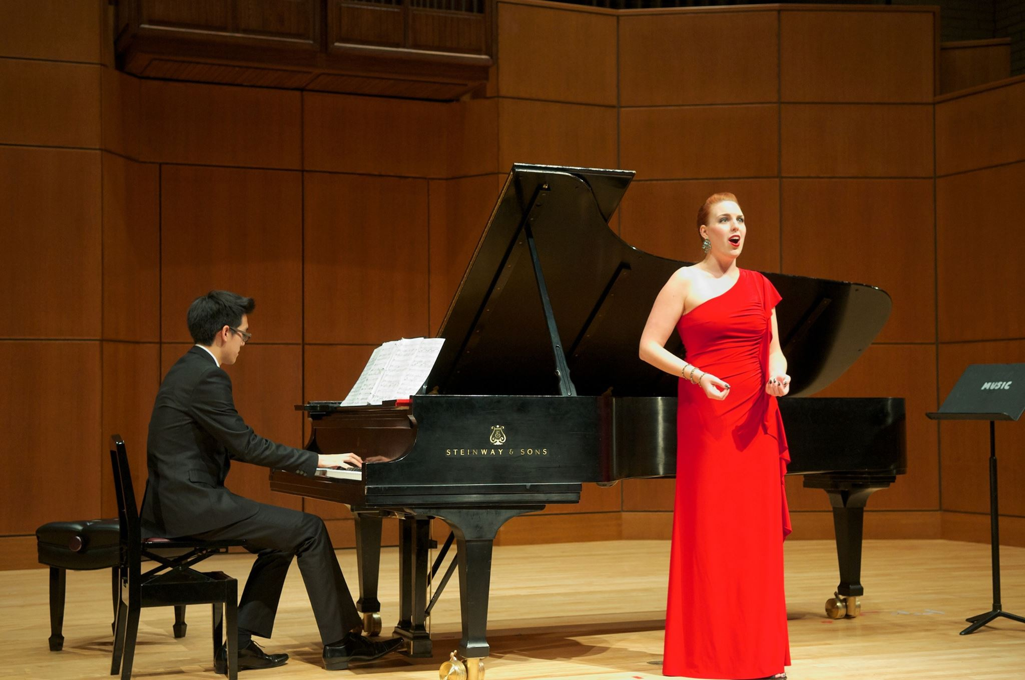 Page singing in a red gown