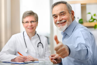 Happy senior patient and doctor at the d