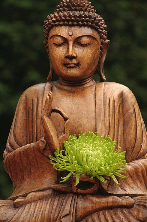 buddha-statue-holding-flower-christine-a