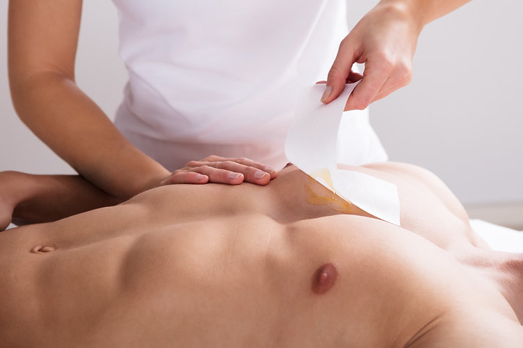 Close-up Of A Woman Waxing Man's Chest W