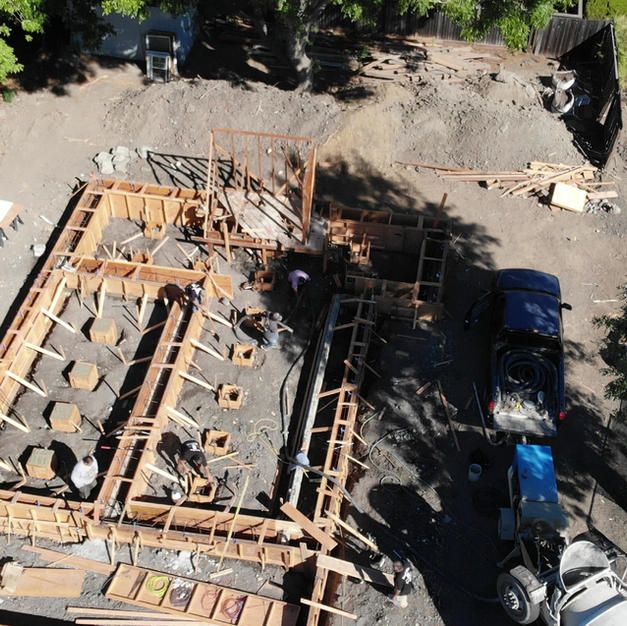 Forming and pouring concrete for footers drone video