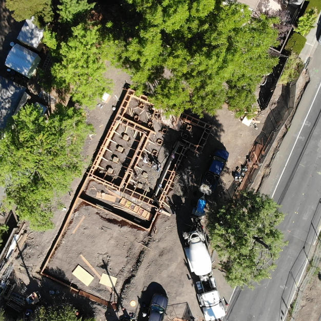 Foundation footers concrete pouring - drone video