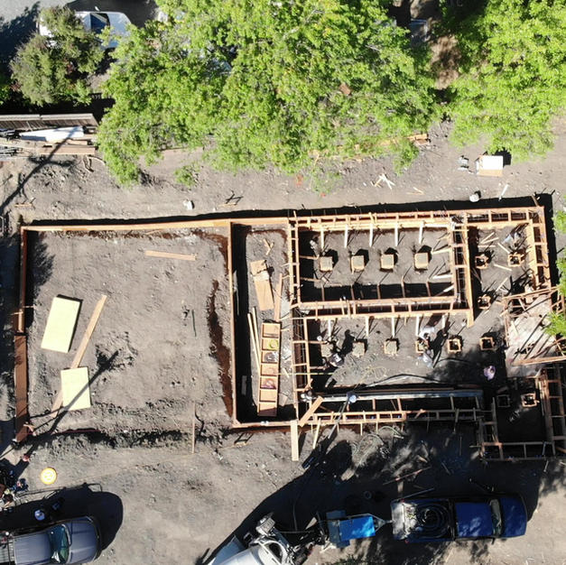Concrete pumping for footers - Bird's-eye view drone video