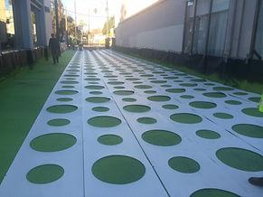 Asphalt decorative concrete stencil installation