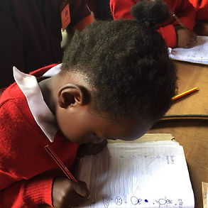 Small girl writing.jpg