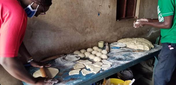 Preparing mandazi