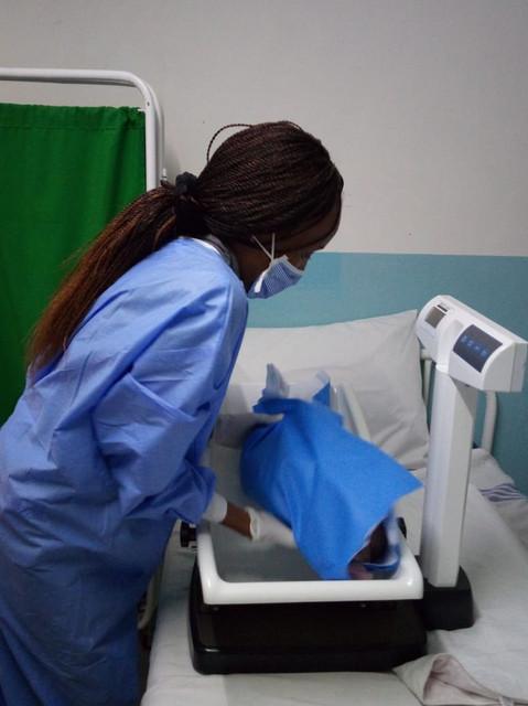 Weighing a newborn