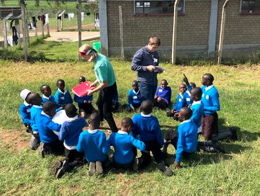 Volunteers with younger students