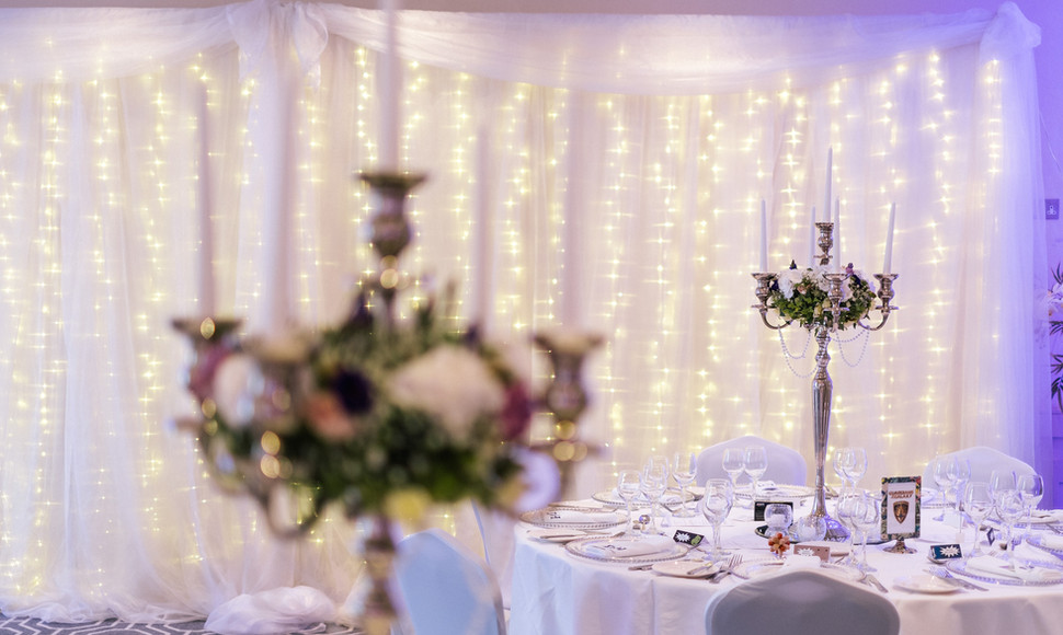 A backdrop to light up your first dance or top table to give the Evelyn Suite that finishing touch. Available in the following sizes.  10ft -  £149 20ft - £249  30ft - £329 (covers the entire wall behind the DJ)  Warm white as standard, bright white available at an additional cost.
