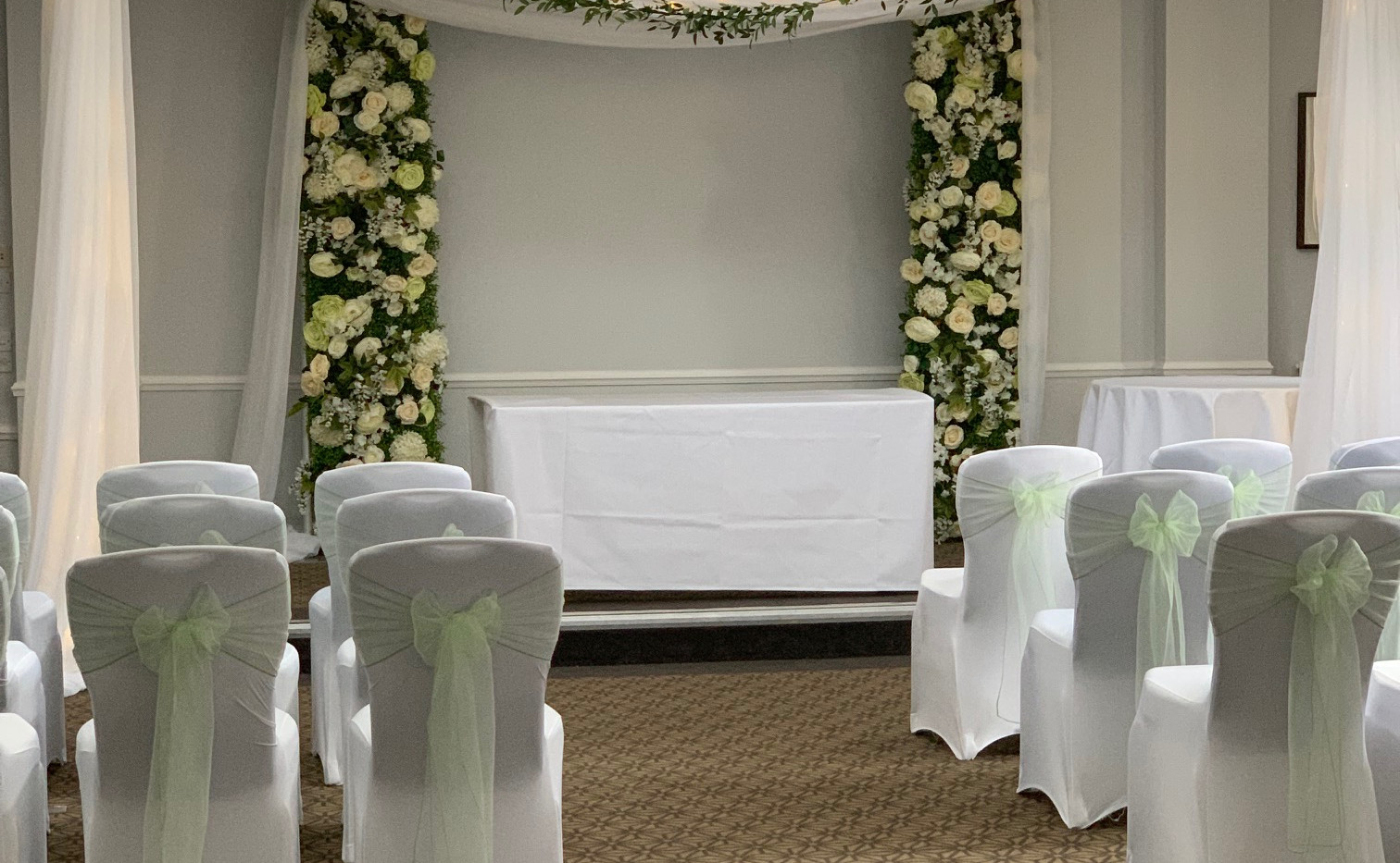 Create that perfect backdrop by adding our stage draping with our 10ft flower wall panel and draping archway.  £250 for both  Ceiling garland not included.