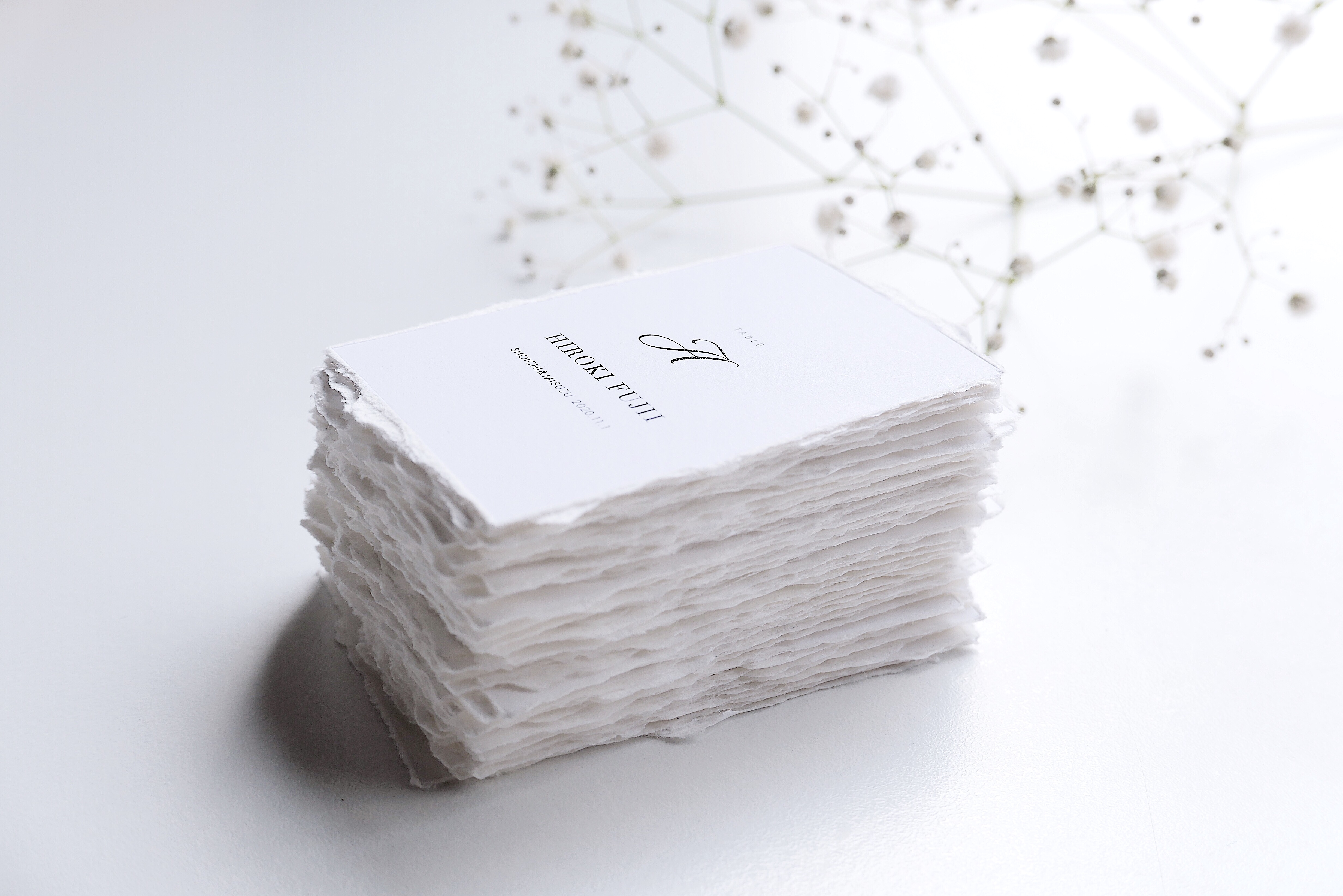 escort card|paper with deckle edge