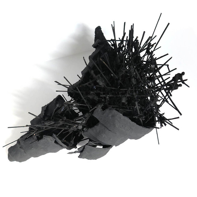 Black Tower, 2016. Plastic figurines, paper, acrylic, plaster and twigs. 40 x 50 x 40 cm