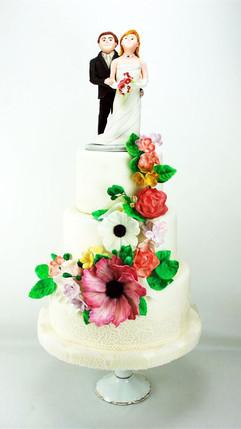 Hochzeitstorte mit bunten Blumen und per