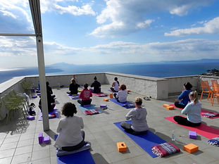 practicing yoga overlooking Capri