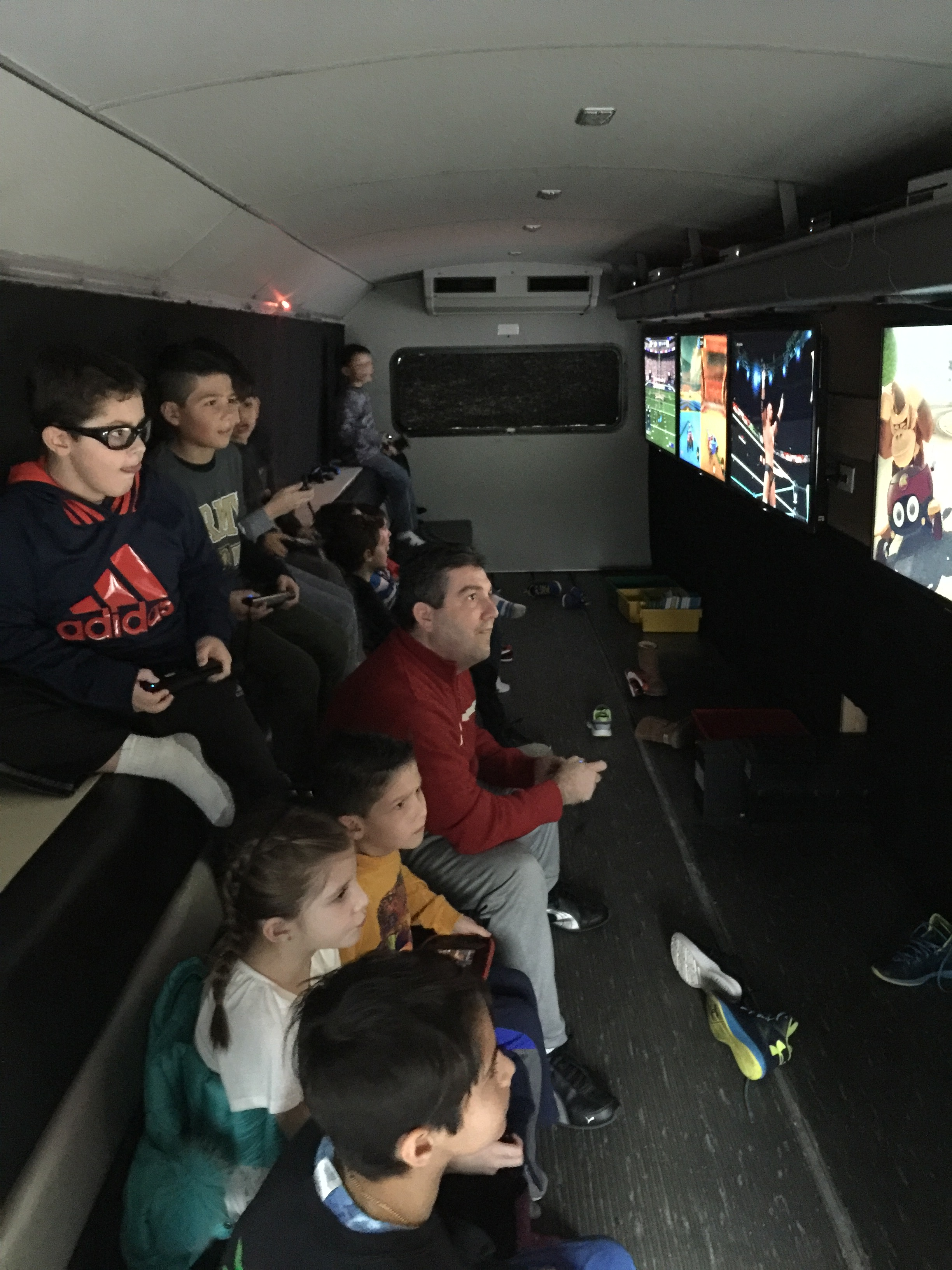 Guests inside Game Bus