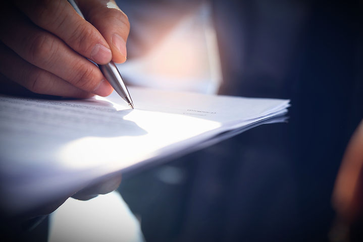 businessman-signing-business-contract-of