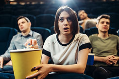 surprised-woman-with-popcorn-watching-fi