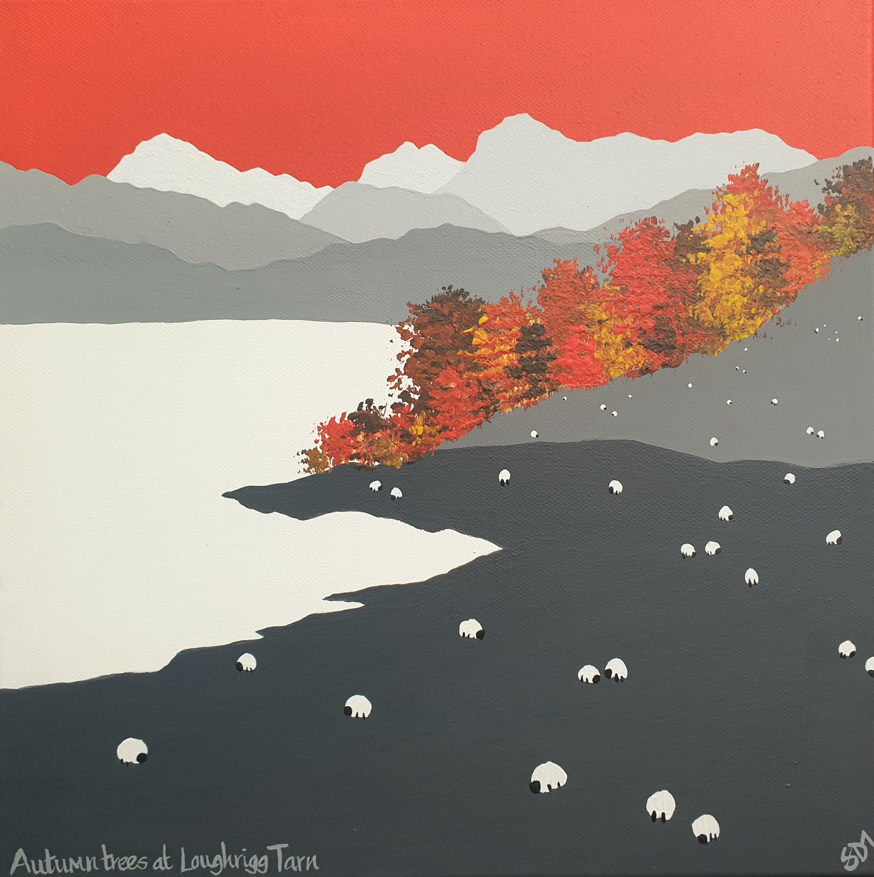 Autumn trees at Loughrigg Tarn