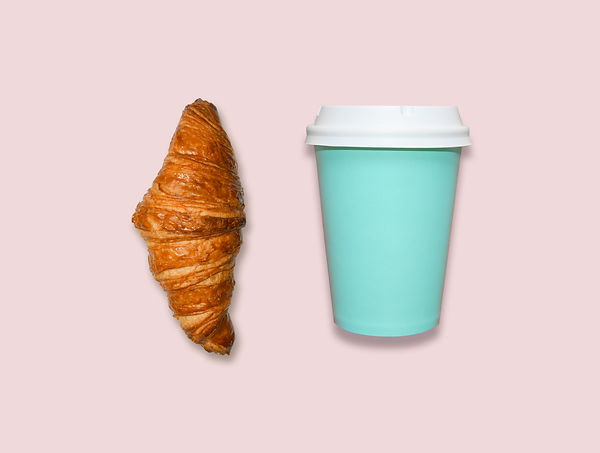 Take away coffee cup and croissant on pi