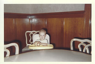Louie in high chair with football - 1959