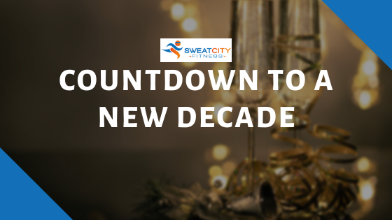 photo of champagne classes and confetti.  Countdown to a new decade with Sweat City Logo.