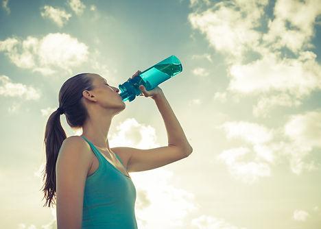 Girl drinking bottle of water. .jpg