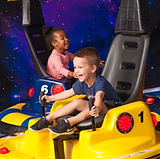 A man having fun riding a go kart with his family on FamTastic Thursdays at Lokomotion Unlimited Go Karts Lazer Tag Spin Zone Bumper Boats and Arcade Games Pizza Deals and Specials Every Thursday