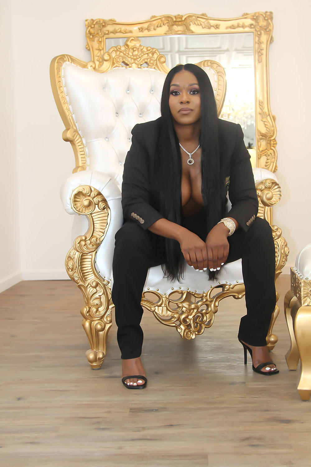 Michelle Smalls demonstrates how sitting the edge of your seat makes you look strong and confident.