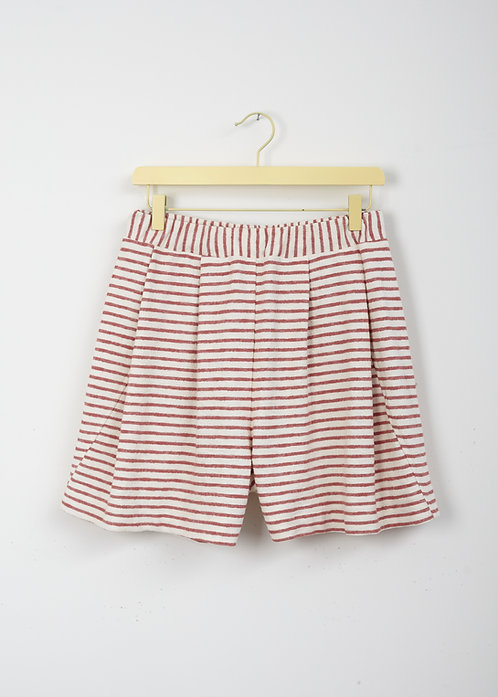 A • PAIR OF SHORTS _a twisted leg